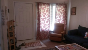 New curtains, rug and vintage rocking chair