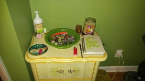 My zen corner next to our bed equipped with lotion, chap stick, candles, my fitness/resolutions journal and stones for meditation
